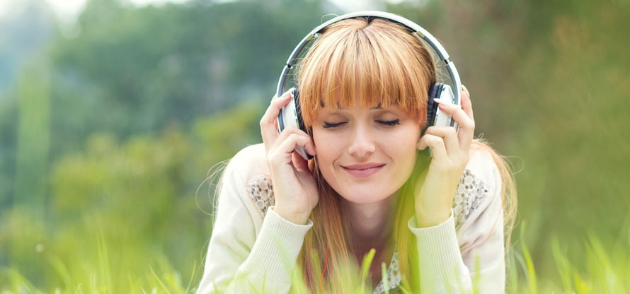 Lady in field with headphones